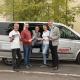 Unser Team vor dem Dorf Bus der Firma Prager Reisen aus Freyung